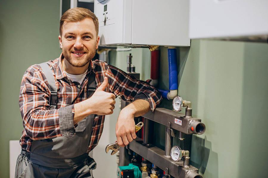 young-engineer-adjusting-autonomous-heating